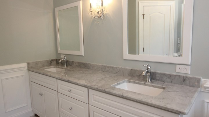 Raleigh master bath featuring white cabinets