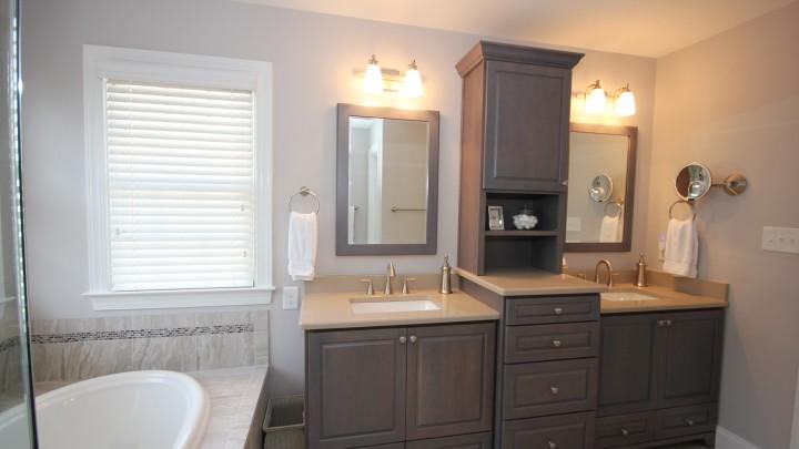 Dark wood custom bath cabinets Apex