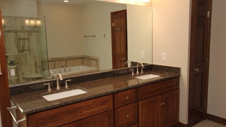 Bath cabinets in dark wood color